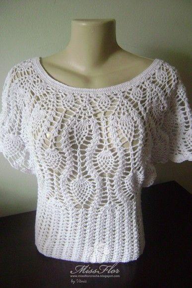 Blusa  em croche  feita  fio 100 algodão de excelente qualidade. Os motivos em ponto abacaxi deram um toque delicado. A blusa é bem justa a cintura. A modelagem é bem atual e moderna. Cor e tamanho preferencial da cliente Tamanhos:P,M,G Outros tamanhos consulte valor ----------------------------------------------------------------------------------------------------------------------------- Blouse in 100 cotton crochet thread made of excellent quality. The reasons given in point pineapple…