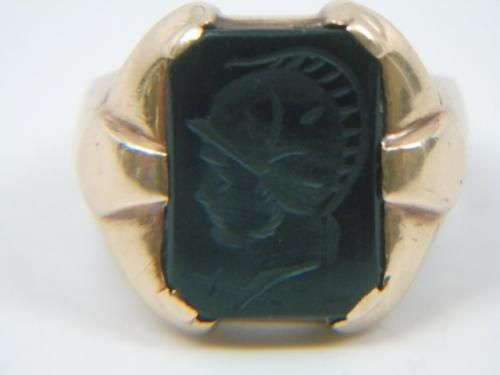 Antique 14kt Yellow Gold Intaglio Men's Ring. Hallmarked interior. Intaglio of a Roman warrior in onyx. Size 9.5, can be resized. Weighs approximately 13.9 g