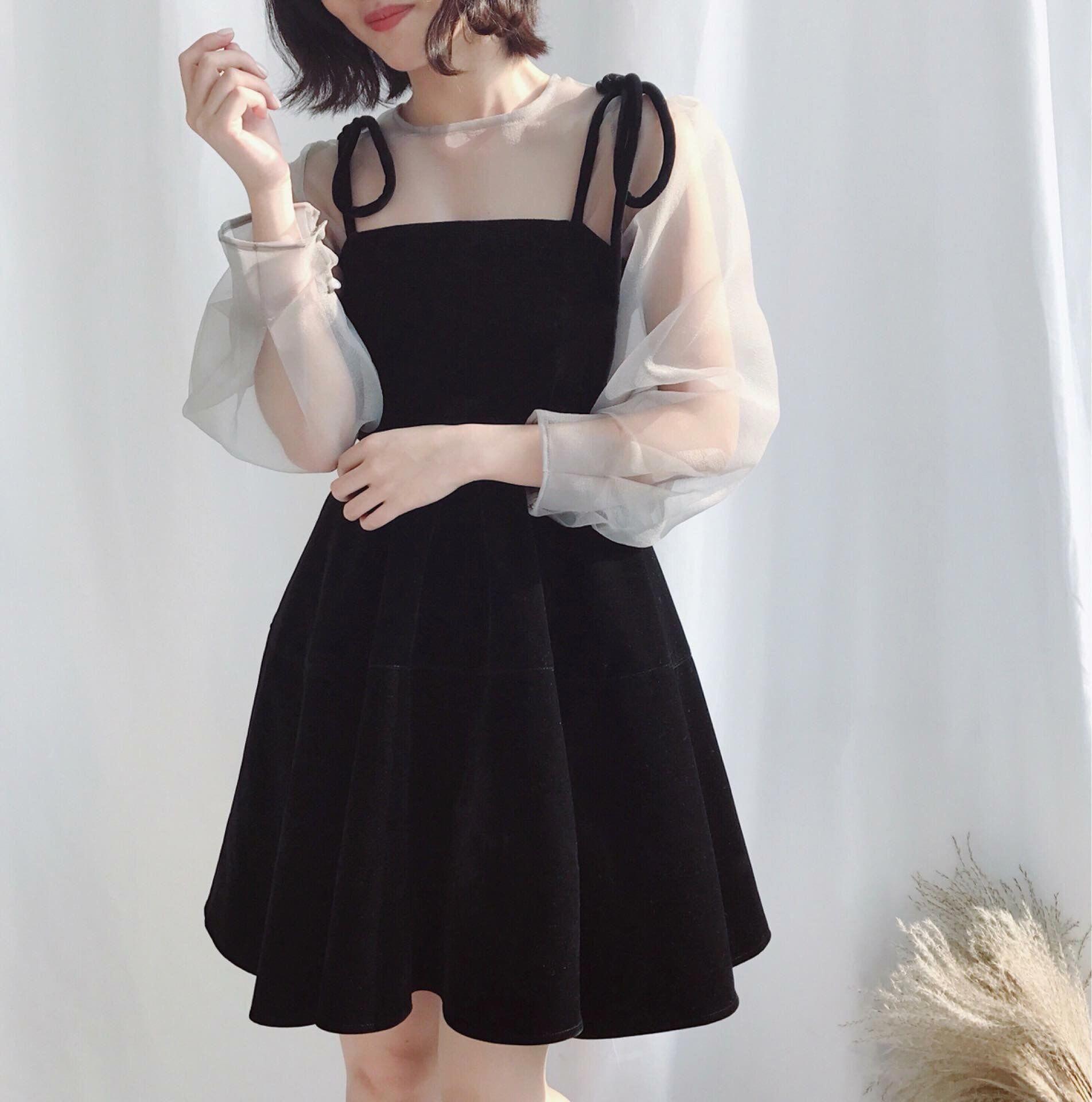 A pretty black dress with white illusion sleeves. #koreanfashion