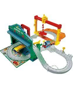 Fisher-Price Thomas & Friends Load n' Go Play Set. Set includes fun features for repairing and constructing, loading and unloading of cargo and features a kid-powered gantry crane. There are 2 signs that can be placed in various plug-in spots onto the play set. There is also a bridge that you can add onto the set that Thomas can drive through. You can load/unload the bridge parts onto Thomas at the front of the station; you can also use the gantry crane. <B>Manufacturer's Suggested…