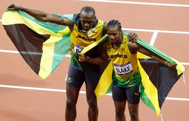 Jamaica's Usain Bolt (L) and his compatriot Yohan Blake ...