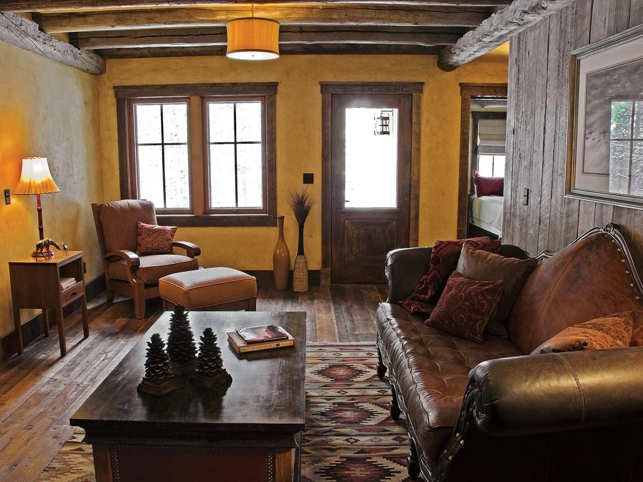 Southwest decor living room  The rustic sitting room in this cabinus guest wing contains a