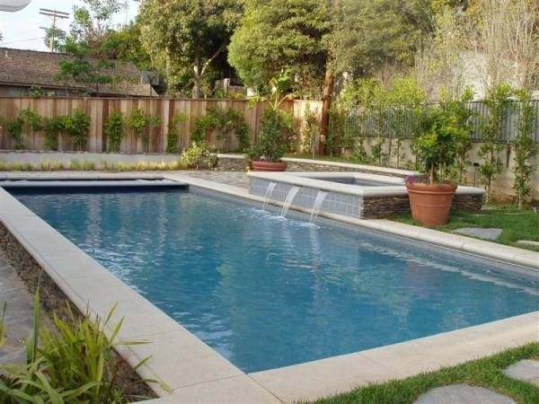 Traditional rectangular pool with a raised spa and (3) spa ...