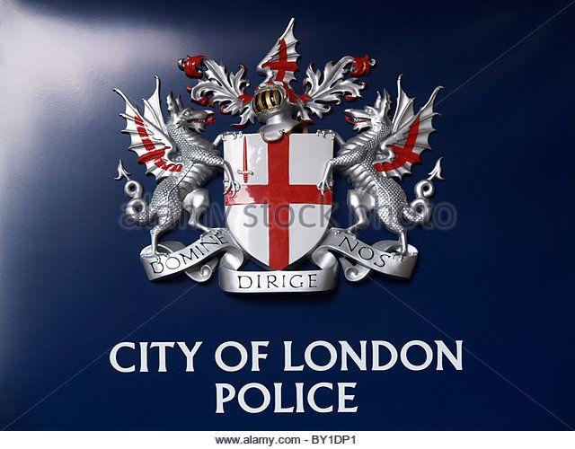 City Of London Police Emblem On Dark Blue Background Shot At