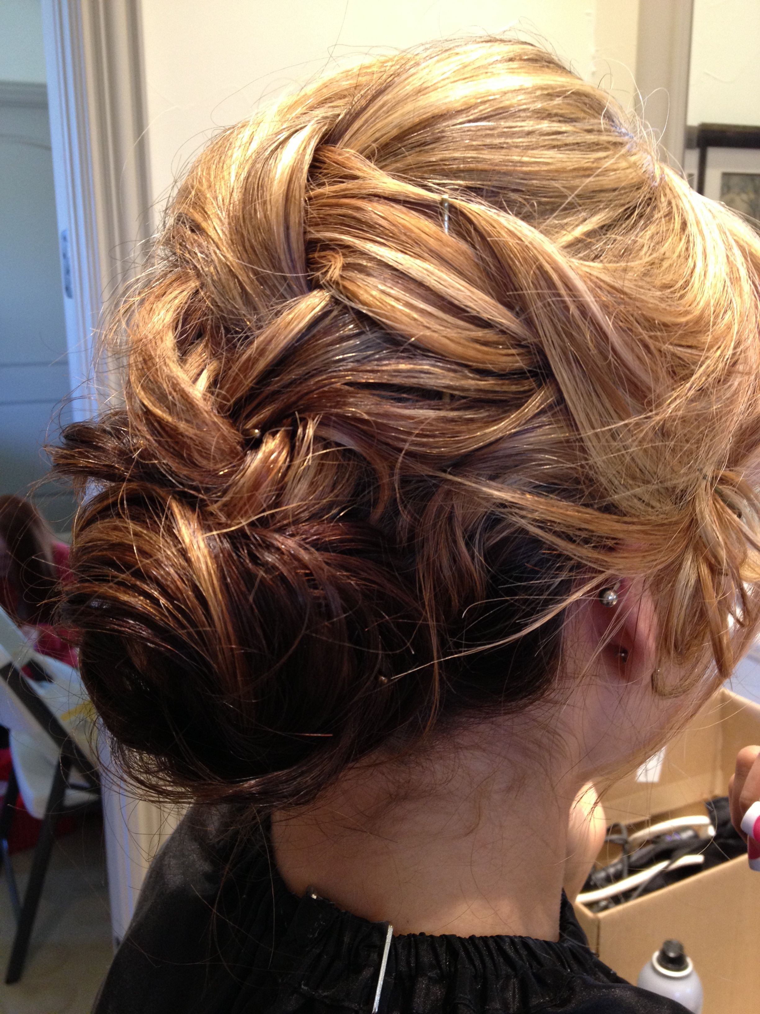 Monica hairstyle loose french braid into low bun chignon formal