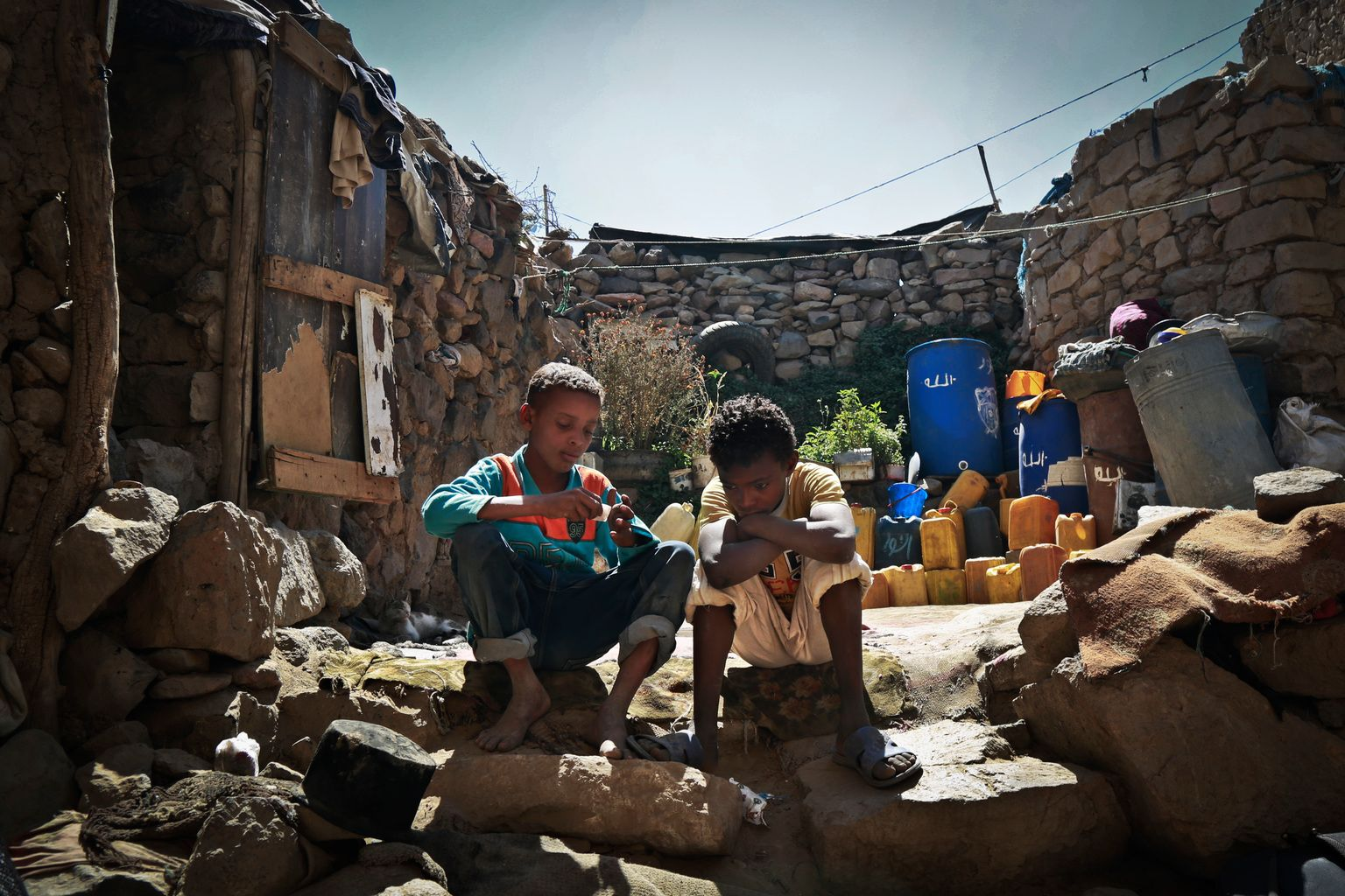 28 March 2016 - Anwar, right, sits with a friend inside his family's house in Sana'a, Yemen. A brutal conflict and a fast-deteriorating humanitarian situation are devastating the lives of millions of children in Yemen and have brought the country to the point of collapse. © UNICEF/UN013948/Shamsa