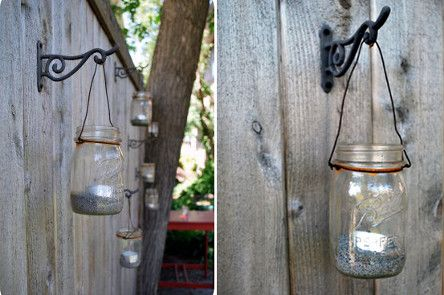 Mason Jars As Candle Holders Hanging Along A Fence Great Outdoor