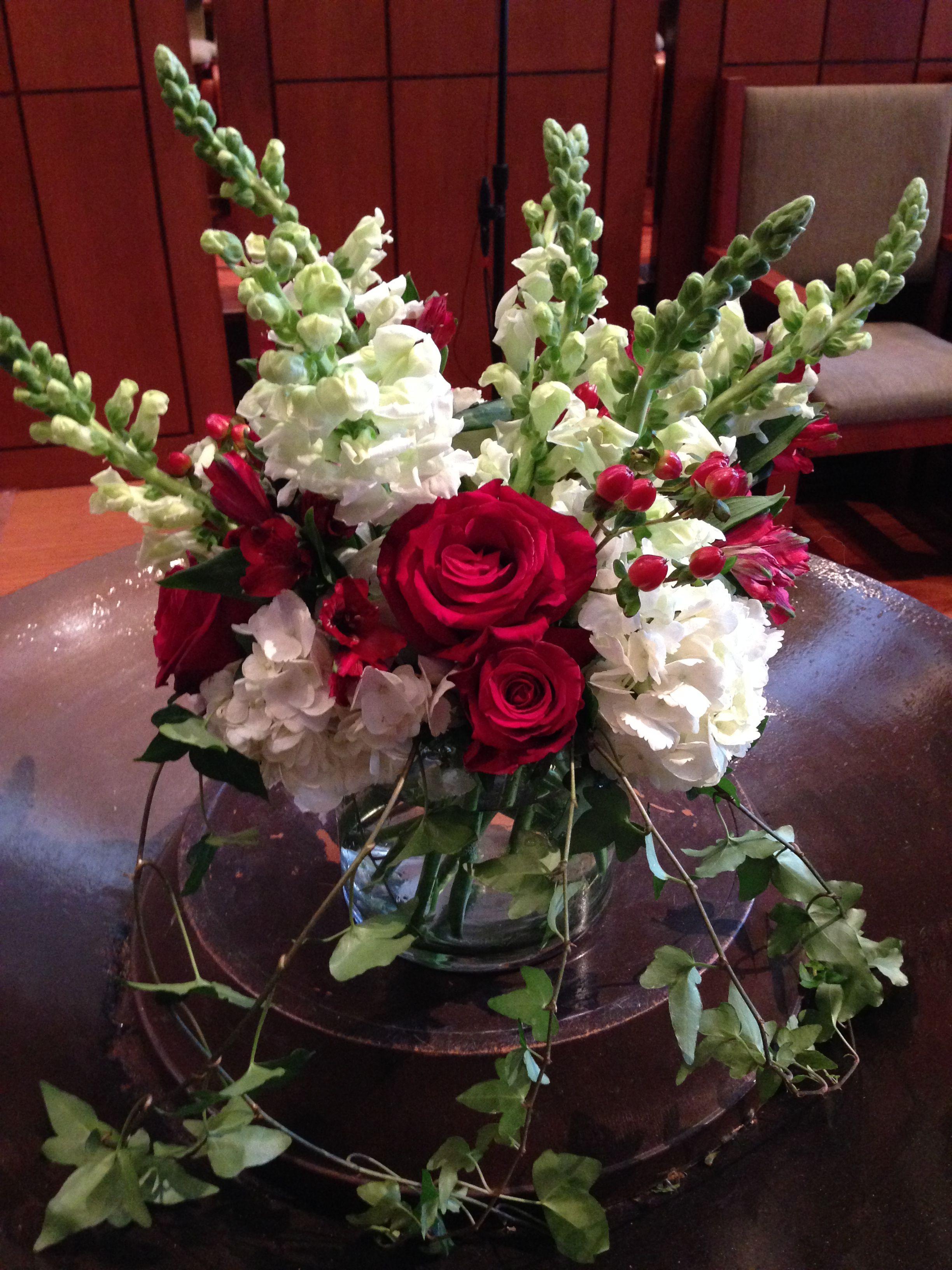 ceremony arrangement; white snapdragons, red roses, ivy, white ...