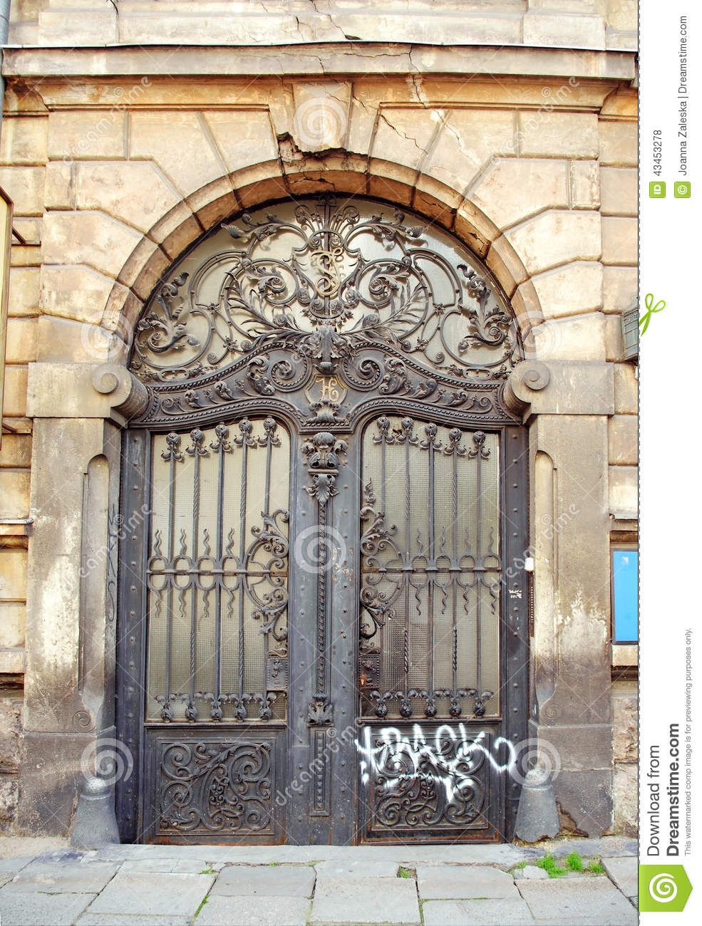 Beautiful art nouveau door gate with ugly graffiti download from