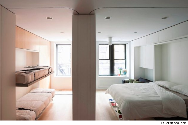 This brilliantly designed 420 square foot tiny apartment in the soho neighborhood in manhattan new york city features a moving wall which enables the