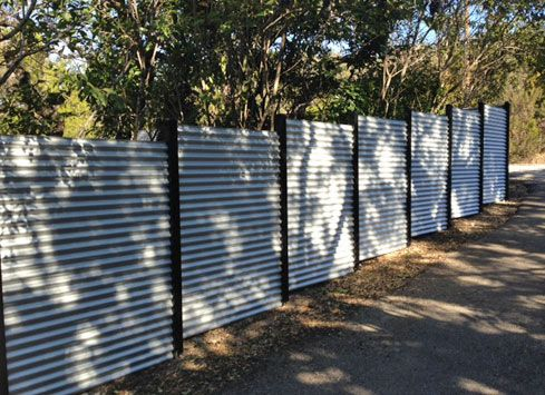 Empire Fence Company Builds Many Different Types Of Fences Including White Vinyl Fences Corrugated Tin Corrugated Metal Fence Corrugated Tin White Vinyl Fence