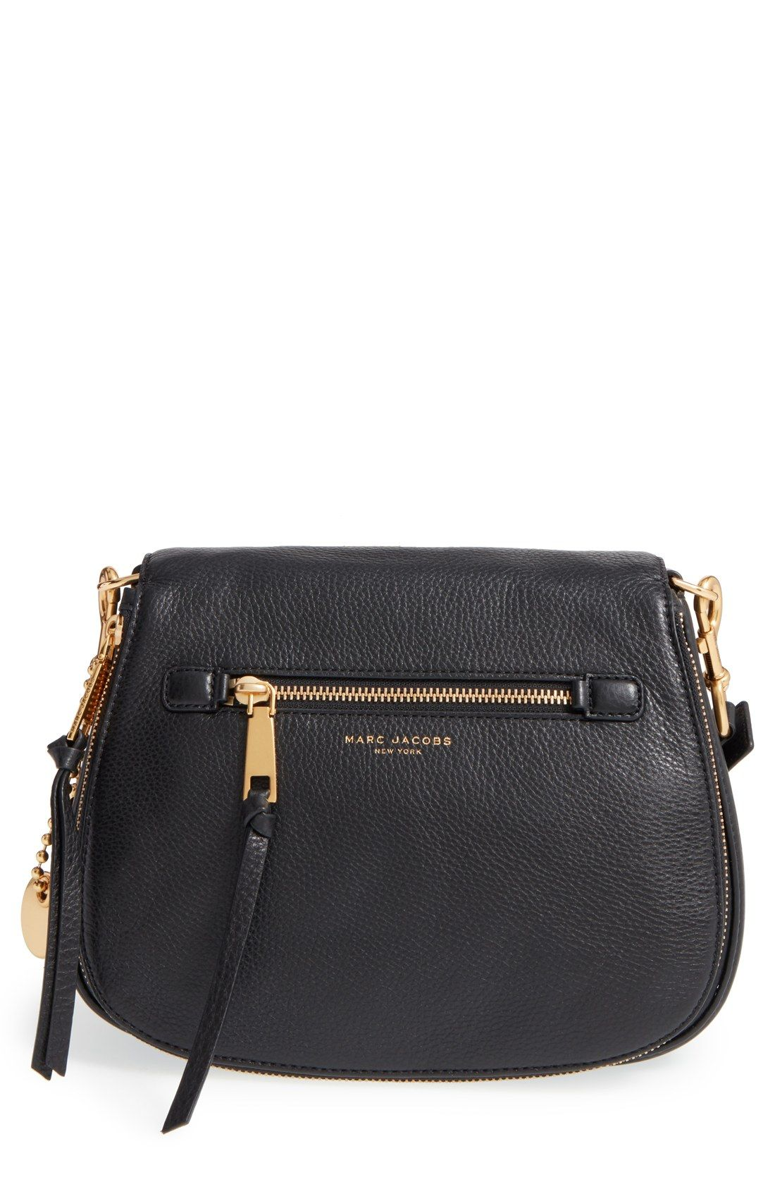 968ba9e8eba90 This crossbody bag from Marc Jacbos has a saddle-bag silhouette and gilded  hardware to polish the look.