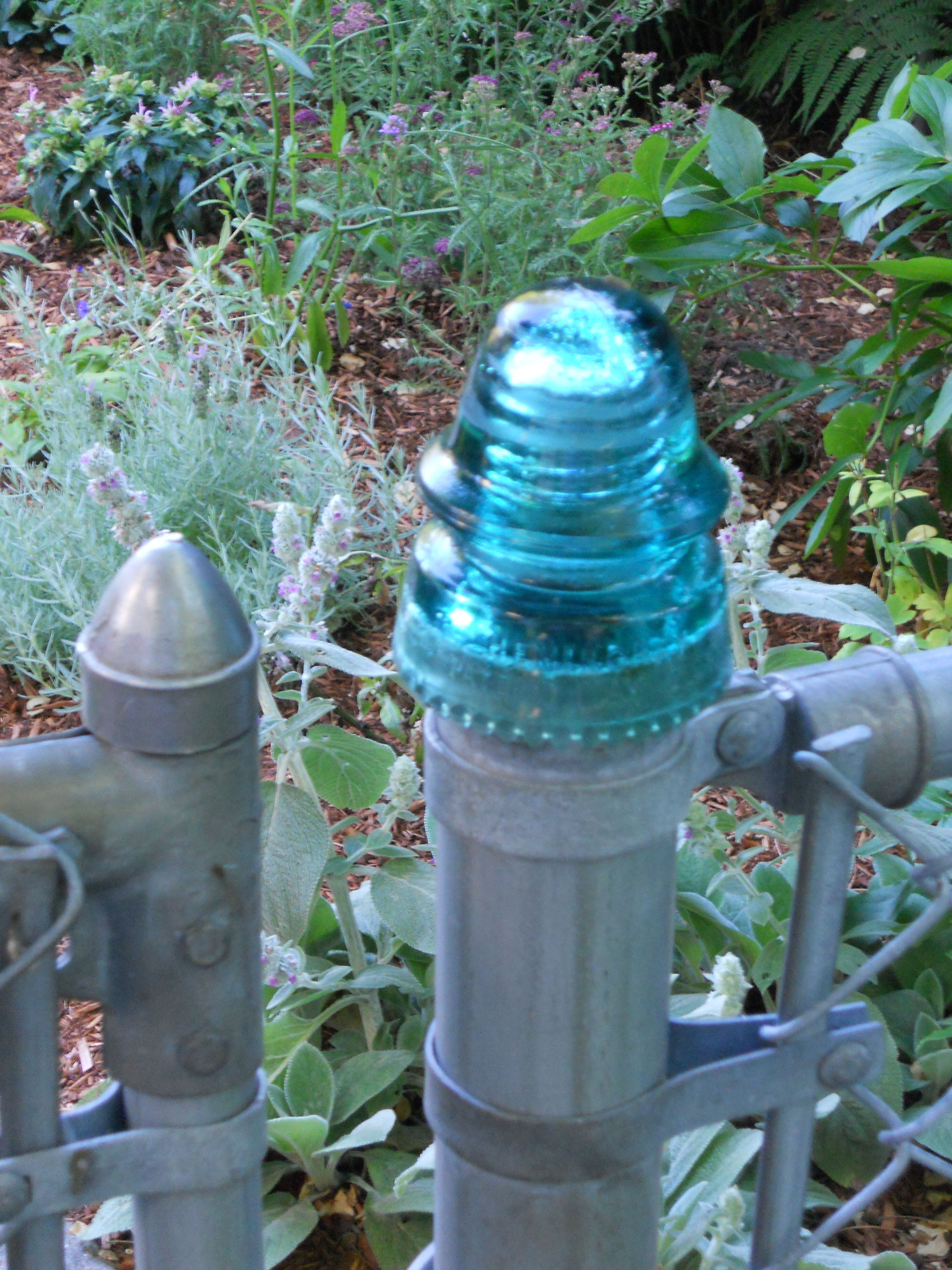 Finally Figured Out What To Do With My Collection Of Glass Insulators They Work Perfectly As Fence Post Finial Glass Insulators Insulation Vintage Gardening
