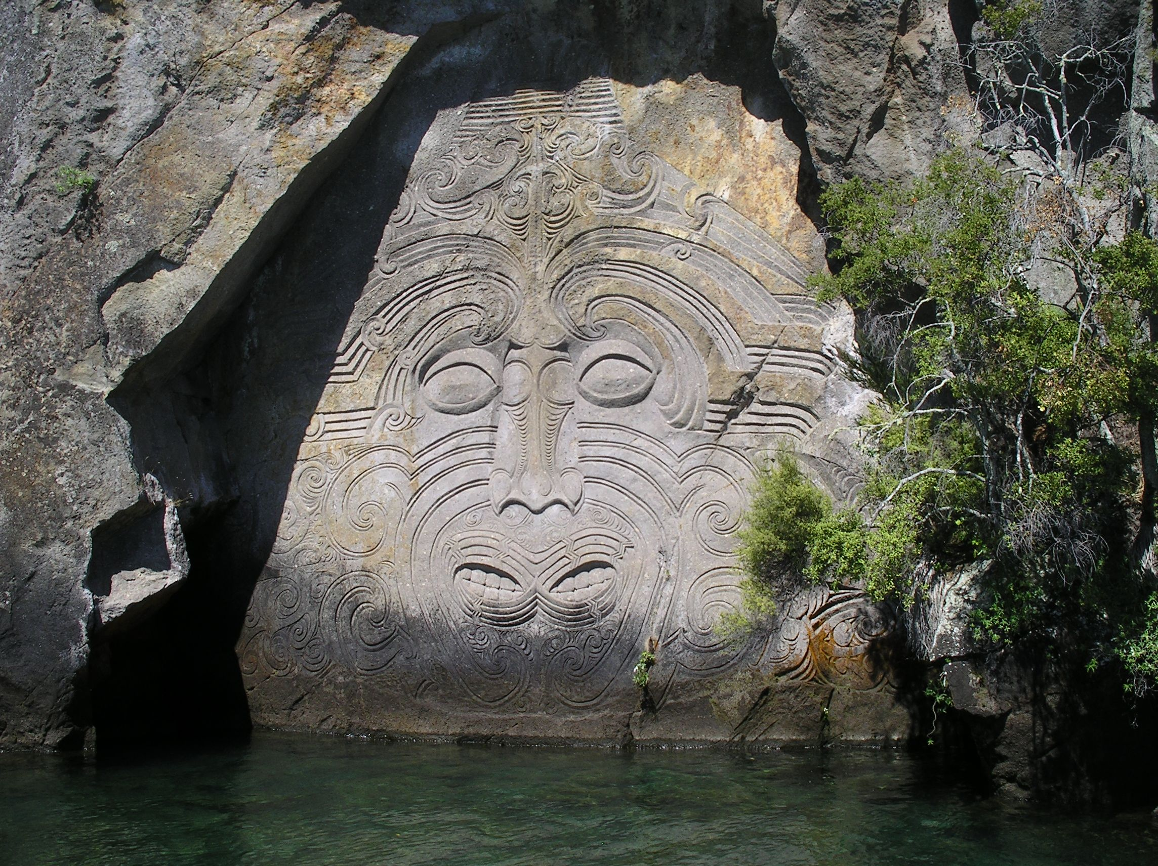 The maori rock carvings at mine bay on lake taupo are