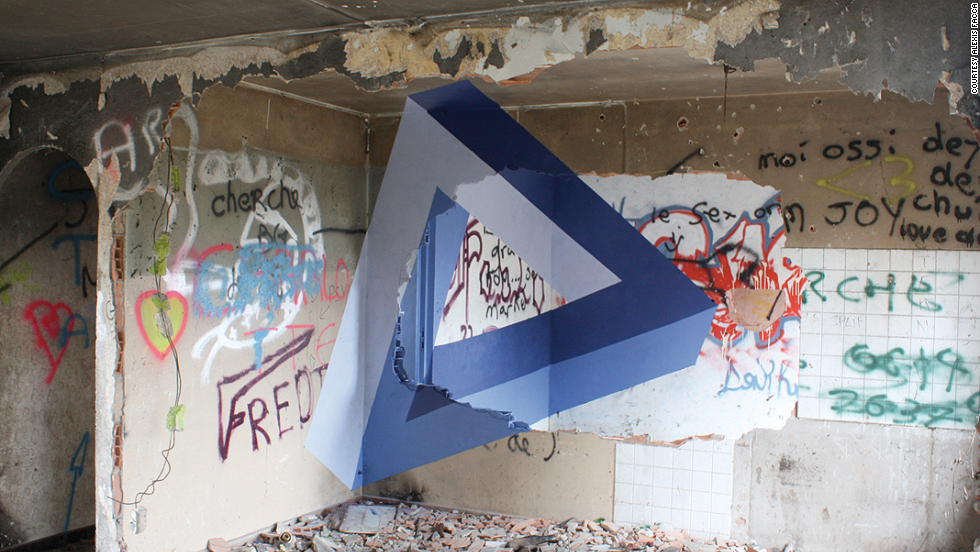 <strong>Alexis Facca</strong><br /><br />The wall-filling geometric shapes resemble perfect origami creations but transplant them onto rough, crumbling buildings. The 3-D effect makes the simple shape appear to rise out of the rubble.