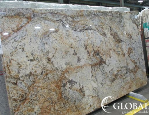 Sagitario Polished Granite Slab Yellow Background With Lines Of Black Mica And Chunks Cream Colored Feldspar Tered