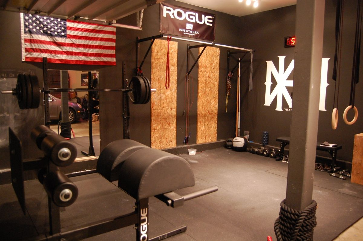 A very nice clean garage gym with awesome abram ghd home gym in