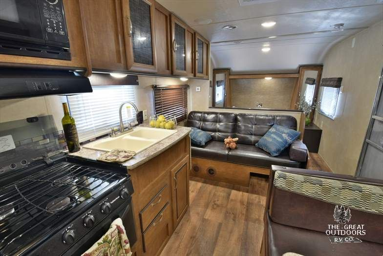 The Wildwood 241QBXL features a queen bed dinette jack knife