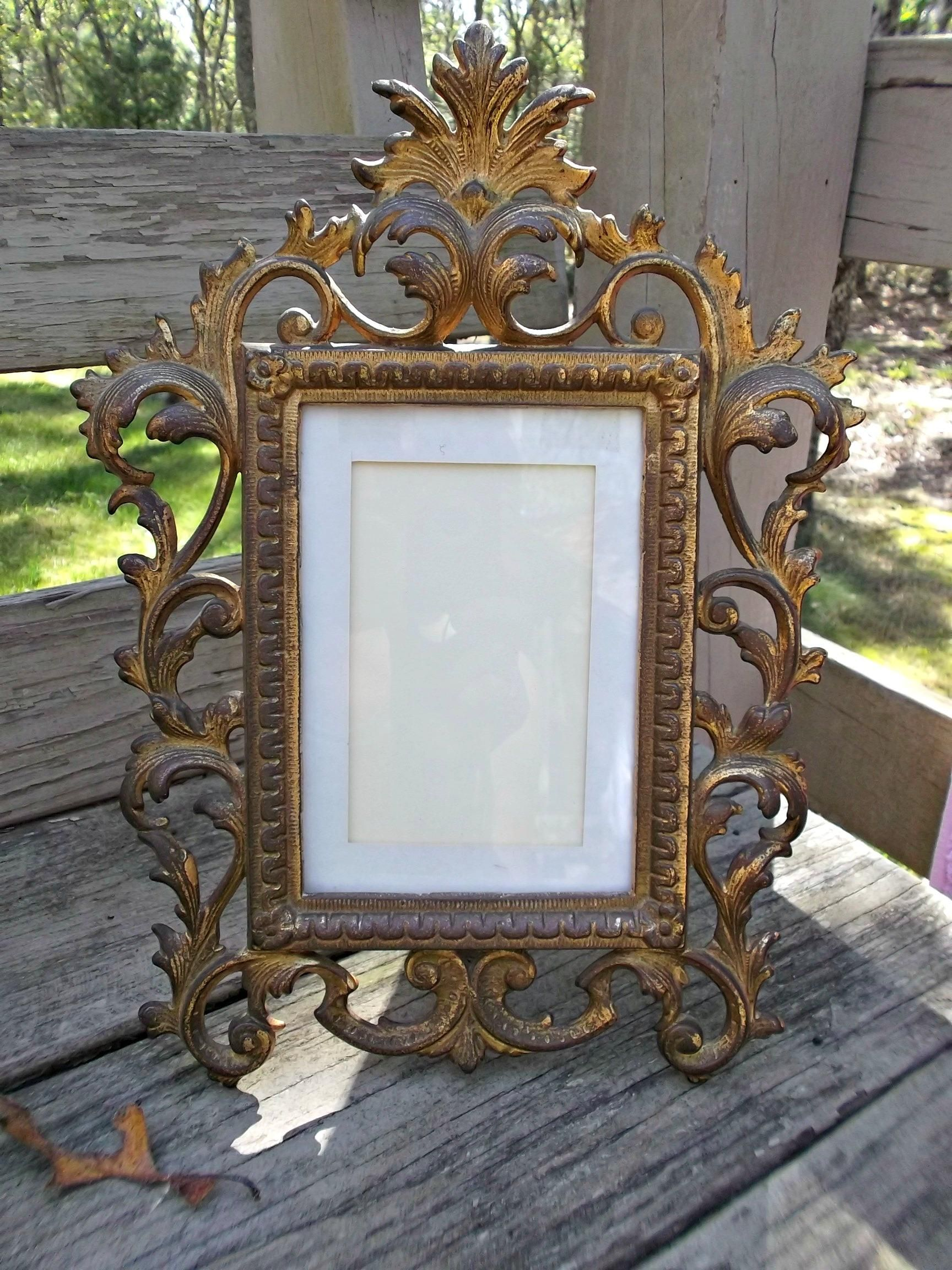 A Vintage Ornate Rococo Style Stand Up Photo Picture Frame In Gilded Metal Cast Iron Lever Back Measures Twelve Inches Tall By