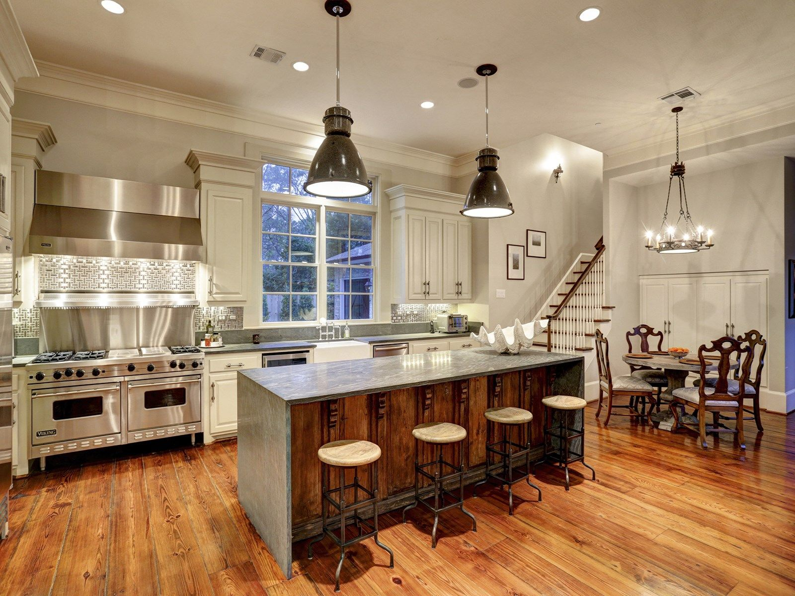 Amazing CHEF S KITCHEN with a professional Viking Range and vent
