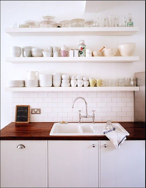Like this for over the stove. I'd like less on the shelves though- little too busy for me.