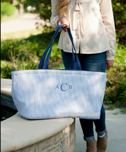 A large Utility Tote for your car or home personalized with a name or a monogram and stores flat. Navy Seersucker fabric with navy accents.