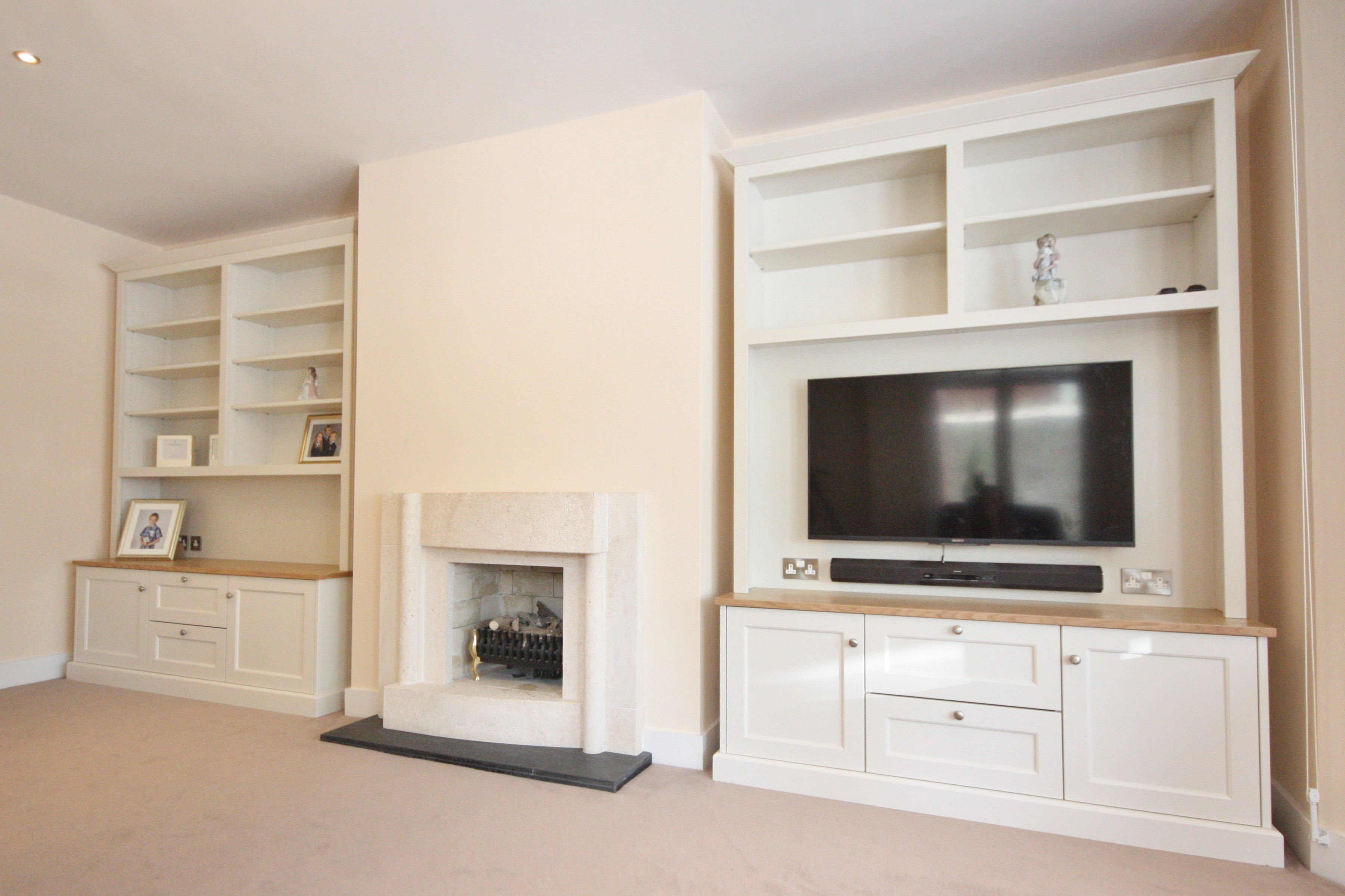 image result for bookshelves and tv cabinet on side of fireplace