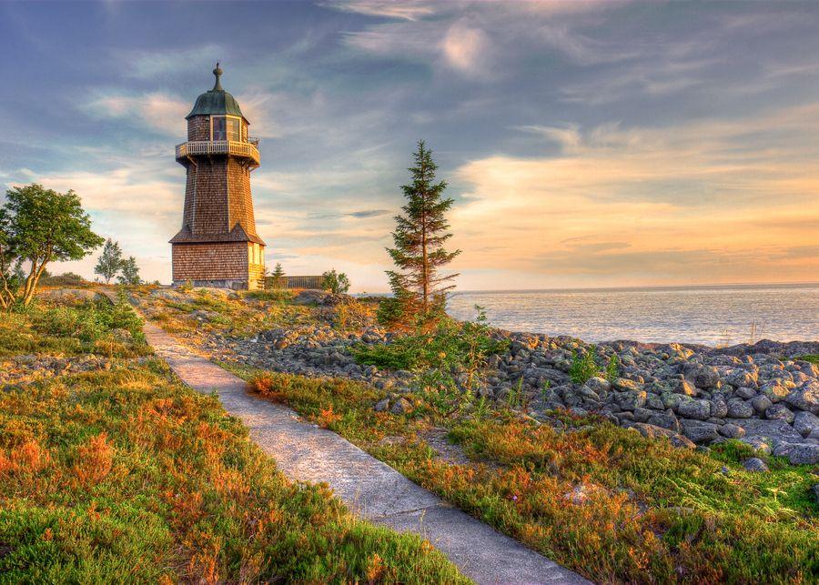 The Lighthouse. The Bergudden Lighthouse on Holmön outside ...