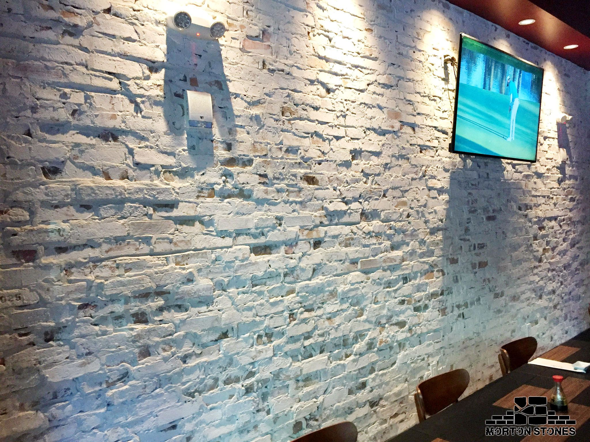 An Elegant Whitewashed Brick Veneer Wall In A Restaurant #Mortonstones