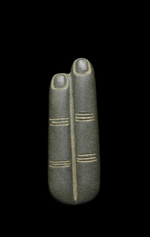 An Egyptian green schist two fingers amulet. Late Dynastic Period, circa 664-332 B.C.