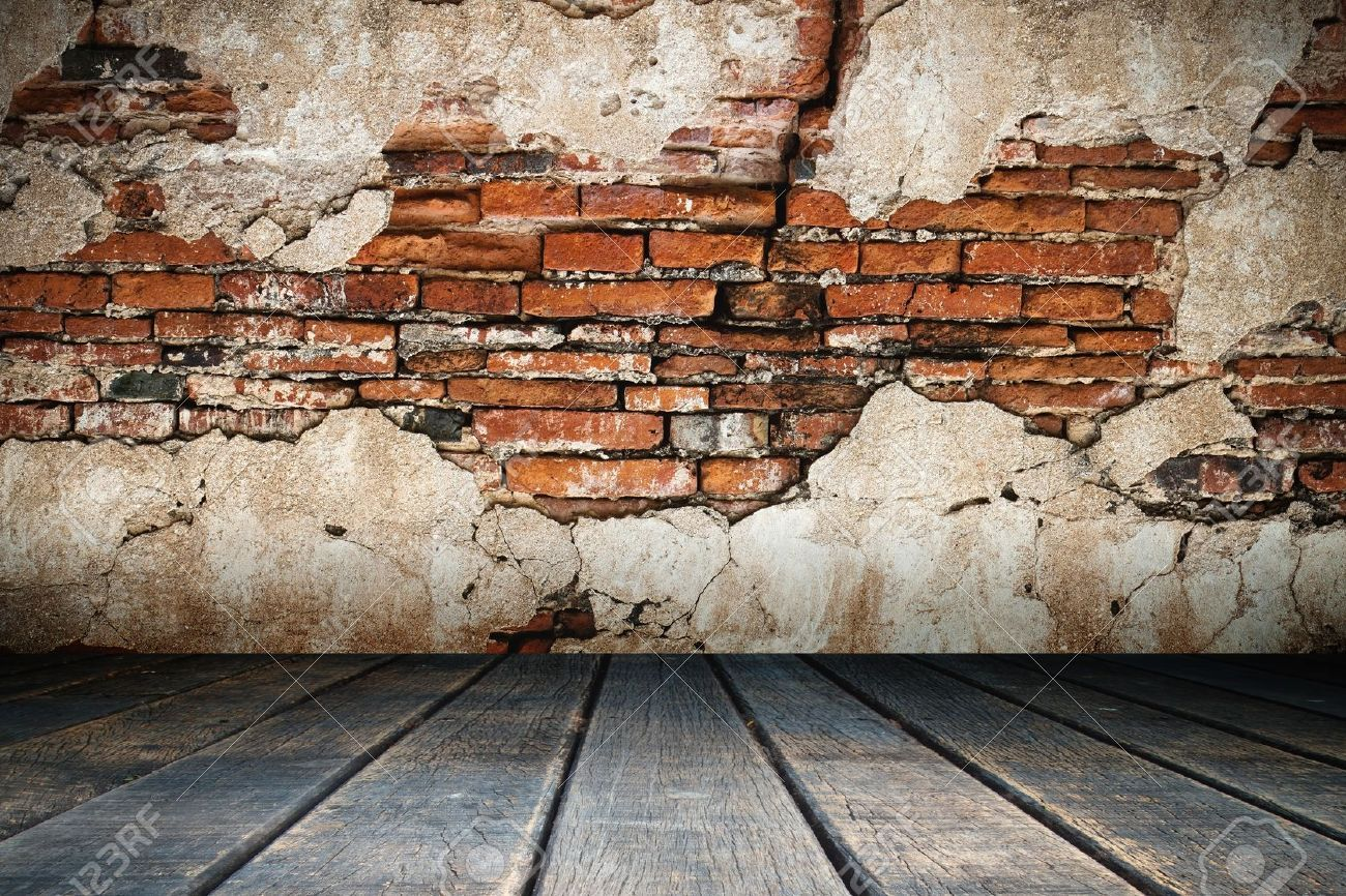 Cracked Plaster Of Old Brick Wall And Wood Floor Brick