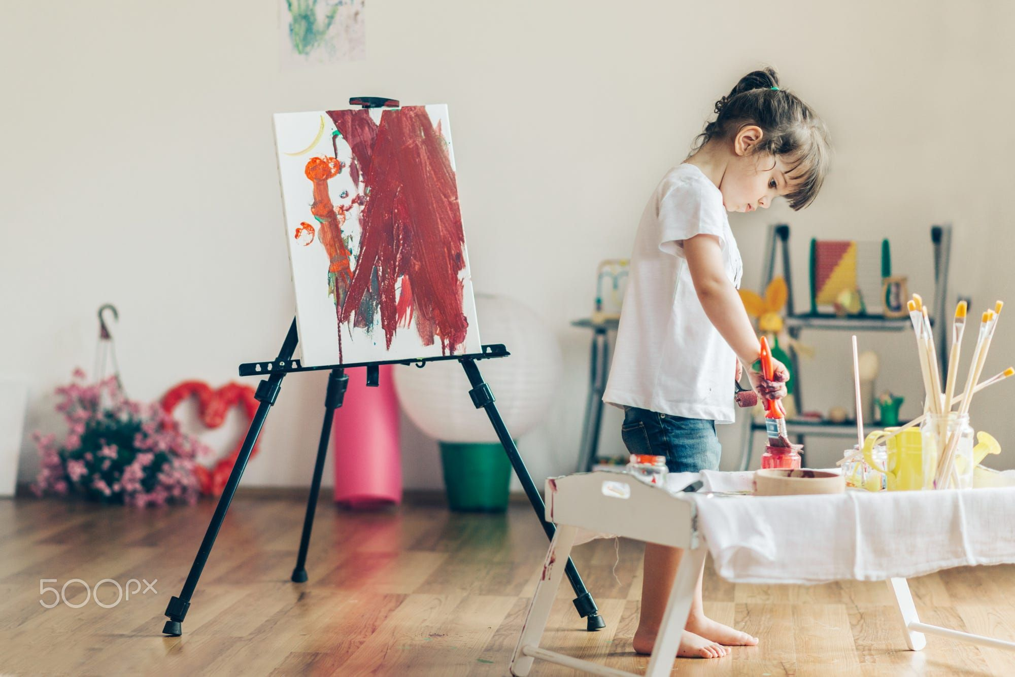 Cut girl painting in at her  home, feel free to see my similar photos.