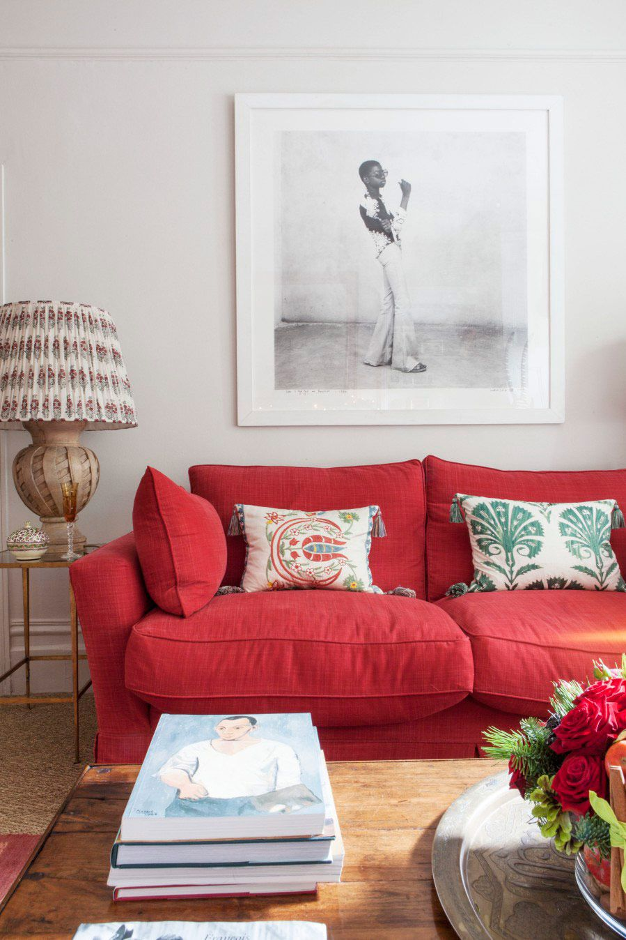 Quirky artworks and patterned embroidery brings a modern - Traditional red living room ideas ...