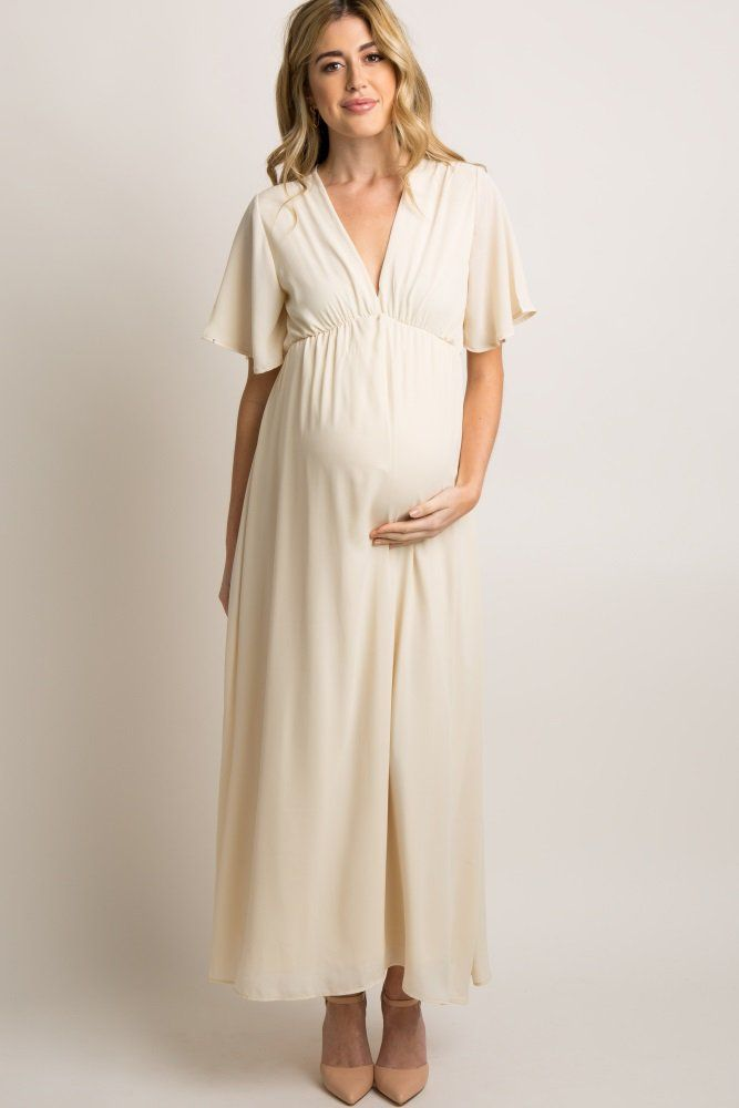 8f99405e9fb55 Solid chiffon maternity maxi dress. Cinched under the bust. Short bell  sleeves. V-neckline. Double lined to prevent sheerness. This style was  created to be ...