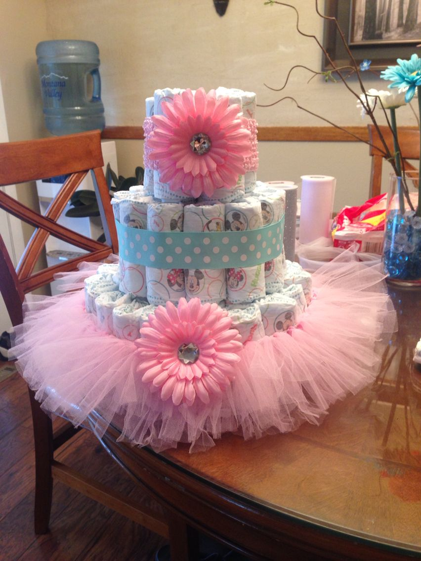 Diaper cake pink with teal accents great for a baby