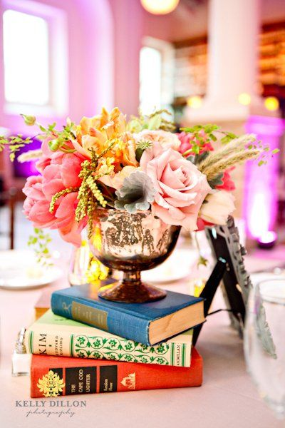 love how the books match the color of the flowers (intentionally or not, this is a fabulous idea for a consistent color palette), photo credit: Petalena