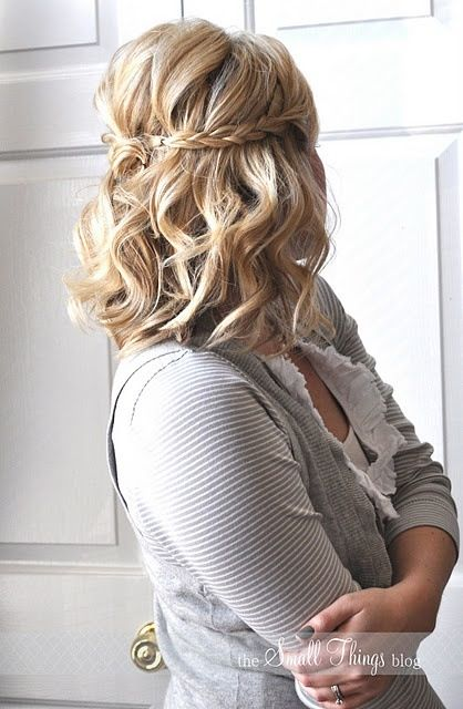 Short wedding hairstyle. U could place your vail were the braids meet
