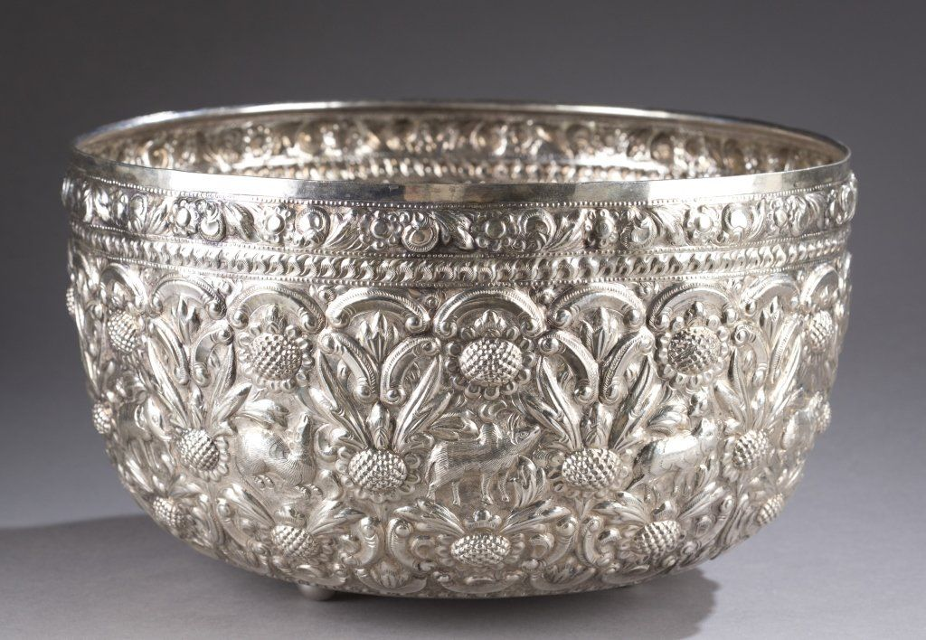 "A Hand-hammered repousse sterling punch bowl. 20th Century. Hebrew inscription on the bottom. 6 1/2""h x 11""diam. Weight: 26.7 t oz."
