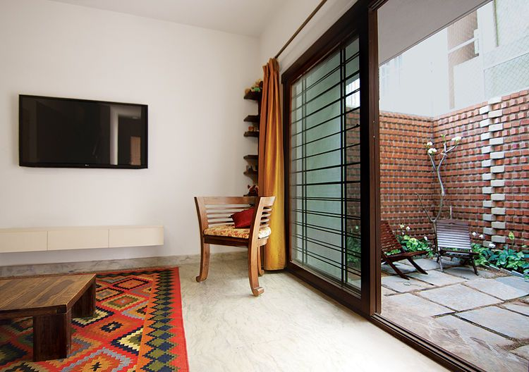 5 City Porches And Patios That Pack Outdoor Space In Small Packages Indian Home Design Indian Living Rooms Partition Design