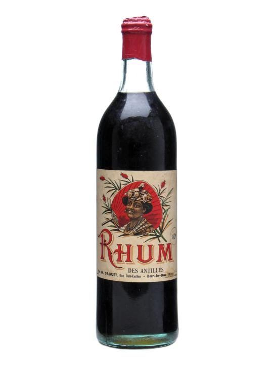 Rhum Daguet 1920 - French West-Indies.   A very, very old litre bottle of dark rum from the French Antilles. Amazing label and condition for a bottle hitting 90 years old.