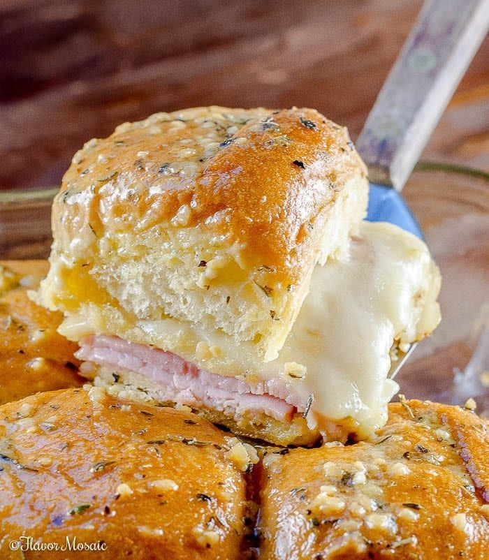These hot Ham and Swiss Sliders, made with sliced ham, Swiss Cheese, and Hawaiian rolls, smothered with a garlic Dijon butter sauce, are a perfect game-day or party appetizer. #breakfastslidershawaiianrolls These hot Ham and Swiss Sliders, made with sliced ham, Swiss Cheese, and Hawaiian rolls, smothered with a garlic Dijon butter sauce, are a perfect game-day or party appetizer. #breakfastslidershawaiianrolls These hot Ham and Swiss Sliders, made with sliced ham, Swiss Cheese, and Hawaiian roll #breakfastslidershawaiianrolls