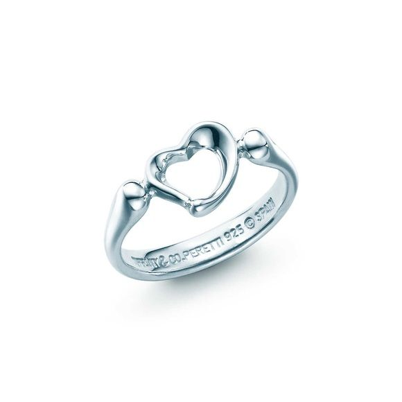 Tiffany's Open Heart Ring Elsa Peretti's most celebrated iconic ring in sterling silver. Condition: Great/light signs of wear on surface. Cleaned of tarnish and kept in plastic zip bag to maintain luster. Comes with dust bag, box, ribbon, care card and gift bag. Thanks for looking! Free gift with purchase  Tiffany & Co. Jewelry Rings
