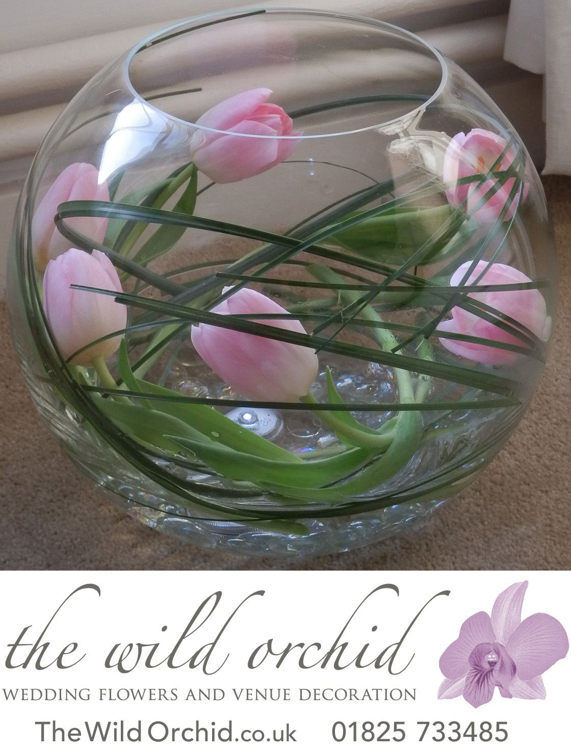 So simple yet so effective a fishbowl vase with bear grass and a fishbowl vase with bear grass and pink tulips wrapped reviewsmspy
