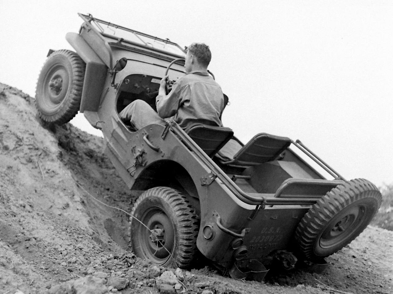 soldier testing a jeep willys mb on steep terrain circa. Black Bedroom Furniture Sets. Home Design Ideas