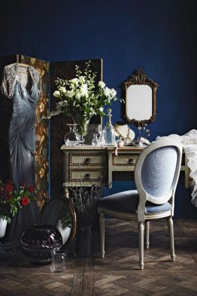 Crystal perfume bottles and fresh flowers on a vintage dressing table - the height of elegance.