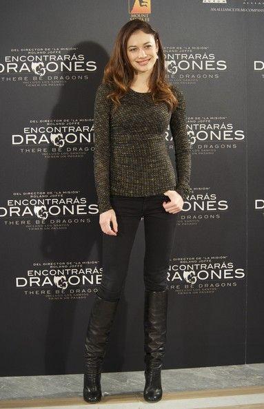 Olga Kurylenko Knee High Boots - Olga Kurylenko accented her casual premiere attire with slouchy black leather knee high boots.