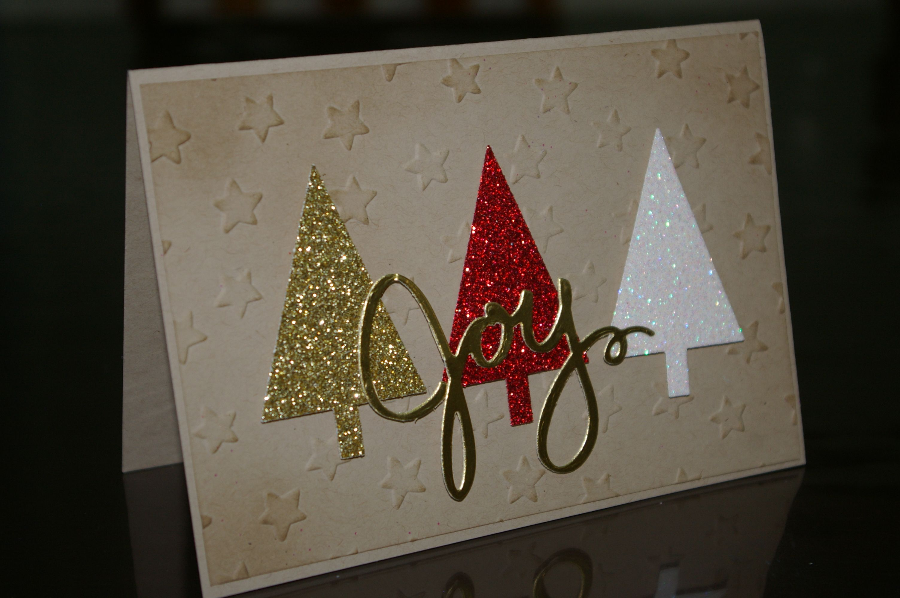 Stampin' Up - Michelle Johnstone - Glimmer paper  Christmas Tree punch & Joy, Lucky Stars embossing folder, Crumb Cake. http://www.stampinup.net/esuite/home/michellejstamping/