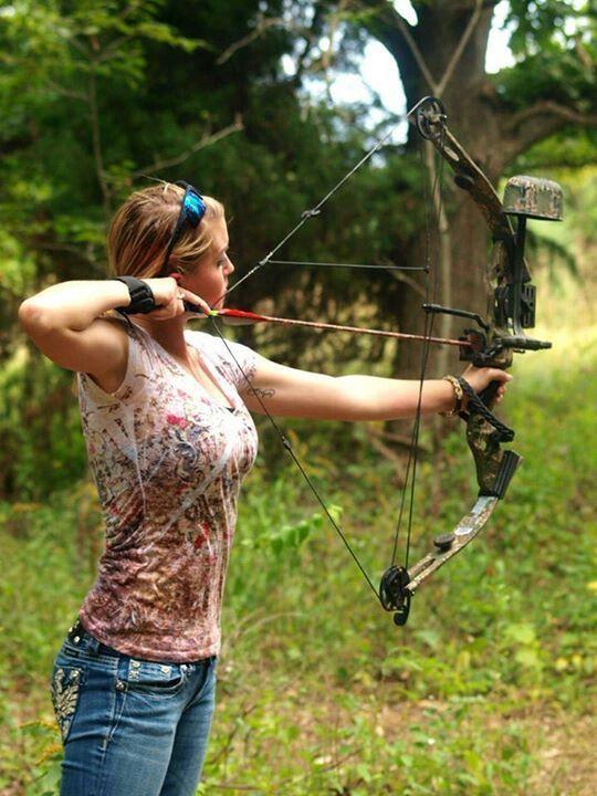 Woman shooting arrow
