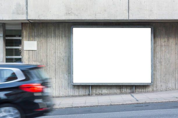 passing car blank street sidewalk billboard metal frame city urban