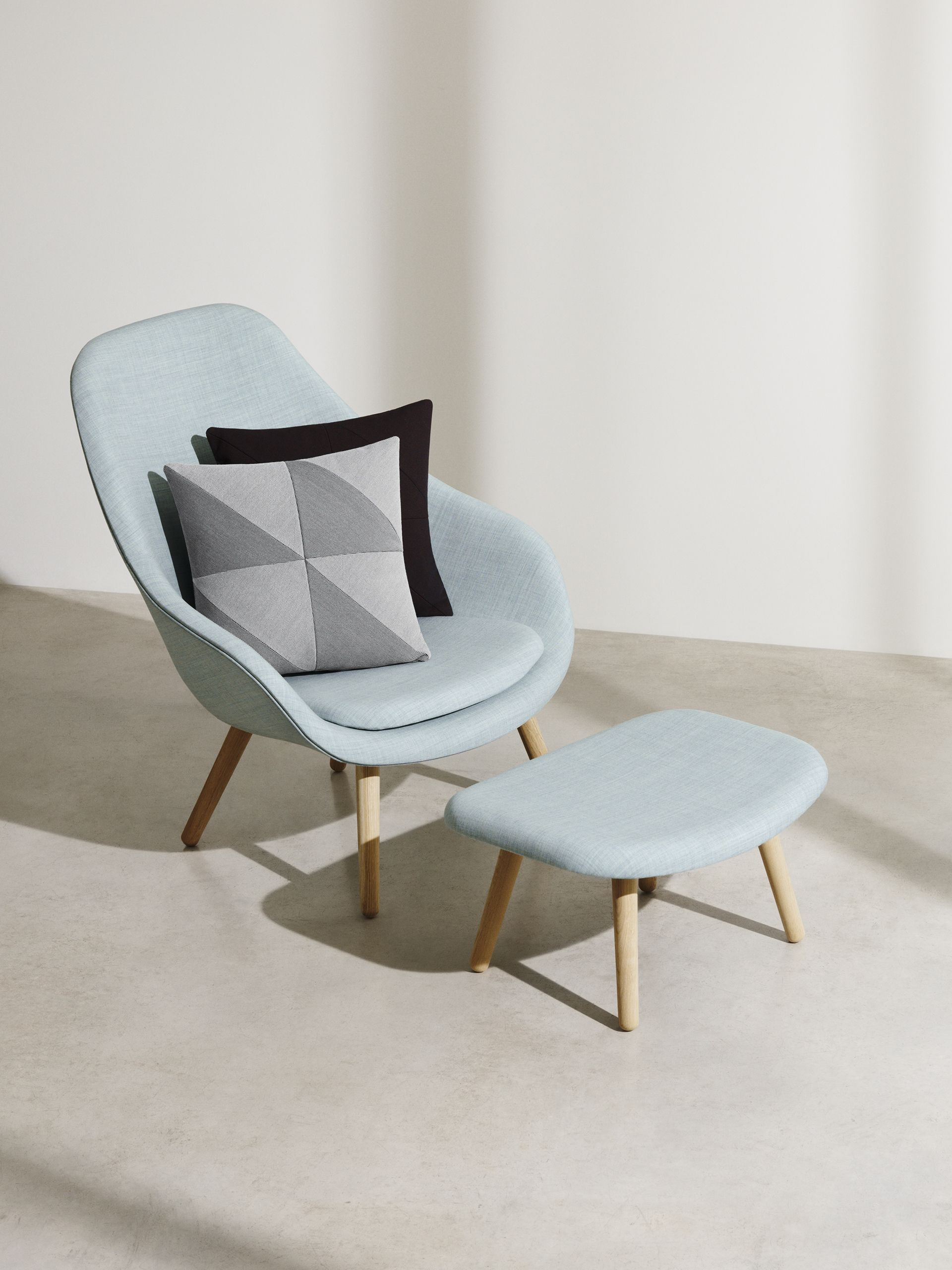 Light blue midcentury chair and matching footstool